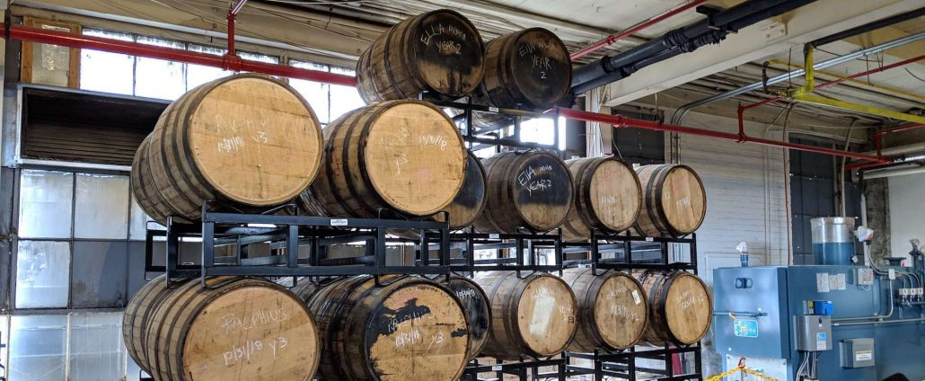 beer barrels at Free Will Brewing